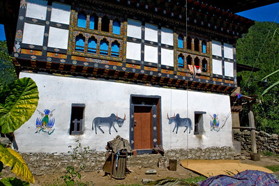 The exterior of the house was unremarkable, at least by Bhutanese standards.