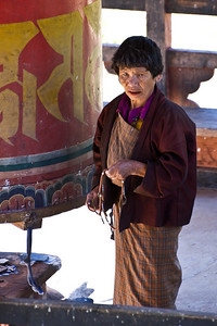 There was also a prayer wheel outside under a gazebo-like roof. This gal was walking around it over and over again, spinning it as she went. She was there when we arrived, and still there still spinning when we left a couple of hours later.
