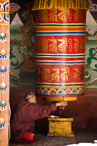 Inside we saw this guy spinning a giant prayer wheel. As it turned out, he was not a worshipper but rather the prayer wheel maintenance man greasing the bearing at the bottom on which it spins. Or maybe he was both. I'm not sure.