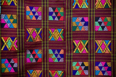 "One of the ""things to buy"" while here is Bhutanese fabric. This decorative fabric is woven largely for clothing. It's obviously very well made, colorful and of an interesting design. Very pretty. This piece was in a small shop on Thimphu's main street."