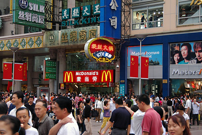 "These two ""cityscape"" photos were taken in the Bizarre next to the Gardens and are part of what I call my ""Where's Waldo"" series. While they are typical street scenes, they each contain an American icon which seems out of place. Can you find them? One thing you'll notice is that there are almost no westerners in these photos. Throughout China I was struck by how few western tourists we saw. I came to believe that China is counting heavily on the upcoming Olympics to bring significant numbers of visitors to China; part of their efforts to join the world's society."