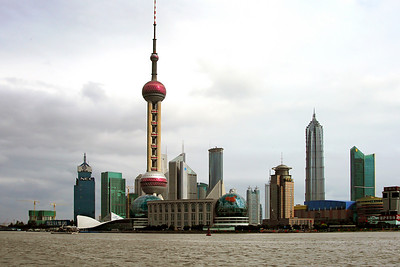 The center of Old Shanghai life is an area called the Bund. Here there are markets, classic hotels, and the old colonial banks and trading houses. This photo was taken standing on the Bund, looking across the river to Pudong. More than any vista, this captures the essence of Shanghai for me. The city is being rebuilt and is home to hundreds of skyscrapers. It will be the site of an Expo World's Fair next year and an Olympic venue in 2008. So China is dressing up the city and it shows.