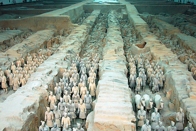 The draw to Xi'an for me was to visit the Terra Cotta Army. Now you may be familiar with this, but if not, the story is interesting. Around 2,200 years ago, Qin Shi Huangdi was emperor of China, in fact he was the first emperor of the Qin dynasty. He was a major architect of the Great Wall of China and a unifier of the disparate parts of China in his time. When he died, his body was entombed and the entrance to the tomb was was guarded by an army of over 7,000 life-sized Terra Cotta Soldiers. Each was created by an artisan and each has a unique figure, facial expression and military uniform. It is said that if the new emperor was dissatisfied with the figure an artisan made, the artisan was killed. Powerful motivation to do a great job!  The first 5 pictures give you a sense of scale. Our first sight was the view you see here.