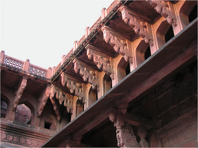 The interior courtyards are richly decorated. This picture shows intricate carved supports just under the roofline.