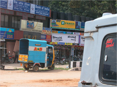 In what seemed to amount to the Indian equivalent of a strip mall, there were many small, multi-story shopping areas along the roads. All were brightly colored. The small three-wheeled delivery carts seemed to do most of the daily delivery. Large trucks would be too big to stop and unload.