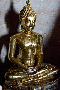 In one of the temples was a small Buddha image. This was perhaps 3 feet tall. It is easy to see where people have bought small squares of gold leaf and rubbed the gold onto the image.