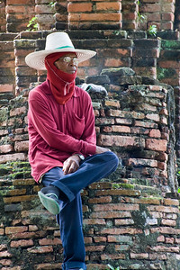 I mentioned we were uncomfortably hot here. During our tour we encountered this maintenance guy. He had been working at raking the gardens and grounds and had stopped to rest. I'm interested in the fact that he's dressed in long pants, an apparently heavy long sleeve shirt, a balaclava and a hat and still, he gives no indication he's hot. What does he know we don't?