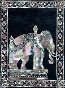 In the temple of the Reclining Buddha, there are some really neat inlaid mother-of-pearl images ... like this elephant, for example.