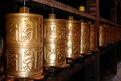 My wife took this photo of a series of prayer wheels. I have a similar photo but hers is better. We saw these all over, in temples, outside temples, on the path up to the Potala Palace. The Tibetans are visible in the practice of their religion and this is just one manifestation of that visibility.