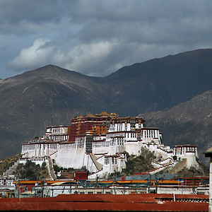 I have a photo I took just in front of the Potala Palace, the home, burial place and monument to 14 generations of the Dalai Lama. But this photo taken with a long lens from across town does a better job capturing the whole of the palace in my opinion.