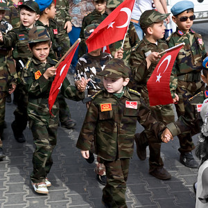 Modern Ephesus: We bumped into an Easter Parade not unlike parades our children marched in when they were this age. I loved these little guys in their uniforms and especially the guy in the blue beret and sunglasses. He's going far!