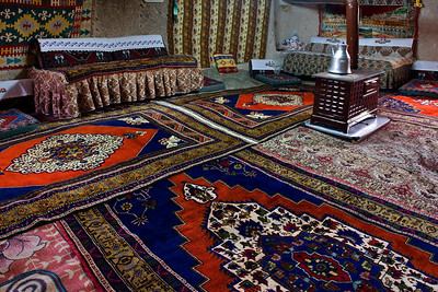 Inside, the rock floors and many of the walls are covered with rugs. Cool in the hot summers. Once the heater warms the place, its thermal mass keeps it warm in cold weather.