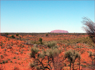 As we approached by bus, Ayers Rock became visible on the horizon.
