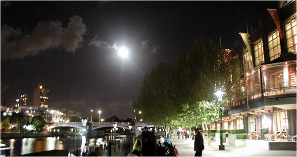 In the early 90s, we had an exchange student from Australia live with us. He grew up just outside Melbourne and the trip afforded us a chance to get together. We had dinner one night at a restaurant at Southbank. I snapped this and the following picture of the setting moon over Southbank as we departed the restaurant.