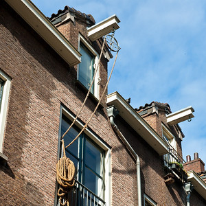 Many of the houses n Amsterdam are tilted toward the street to allow a rope and pully system to hoist furniture to upper floors. This causes the funny angles you see here and adds substantially to Amsterdam's charms.