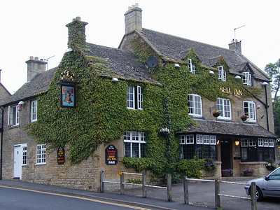 As you enter Stow On The Wold from the north, there is a small (free) parking lot. Leaving the lot and walking into town, you first encounter the Bell Inn.