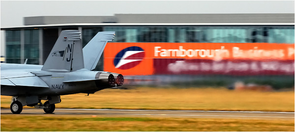 The F/A-18F Super Hornet is the US Navy's primary fighter. It has replaced the F-14 Tomcat in its air defense role, which in turn replaced the F-4 Phantom. Unlike the Tomcat, the wings are fixed geometry.