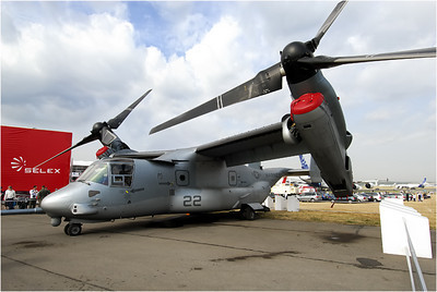 Another unusual aircraft at Farnborough was the Bell Boeing V-22 Osprey. As you can see in the photos, the two engines are mounted at the tips of the wings and can be rotated so the propellers point up or forward or somewhere in between. So it takes off and lands like a helicopter. Once airborne, the rotors tilt forward and it flies like a conventional, if goofy-looking, aircraft.