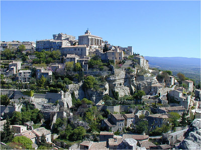 To approach Gordes, you'll need to drive up a steep, narrow road. Near the top, if you glance to your right, there's a great view of the village. Just to the left of where this photo was taken is a hotel with one of the best views in France.