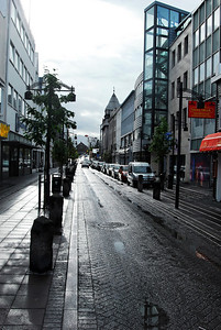 Streets:  The weather in Reykjavik was troubled (from my perspective) but arguably normal for this time of year. Cool, with wind, thunder showers, followed by rainbows. Lather, rinse, repeat ... as they say. To be honest, I was jet-lagged, hungry, and a bit grumpy and the city didn't make a very good first impression on me. But as I got to know it better, I liked it better and better. By the time we left, I was sorry to say goodbye.