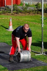 "Strong Man Contest: We were walking around town and heard cheering from a small park about 50 meters away. We walked over and found everyone in town enjoying the local ""Strong Man"" contest. A dozen or so fellows were competing. They had erected a barrier and the test was to heave an empty beer keg over the barrier. Everyone had a go, and if you succeed in getting your keg over the barrier, you continue to the next round. You get two tries each round but have to succeed only once.  Before the next round, they raise the barrier. The lone man to get the keg over the highest barrier is the strongest."