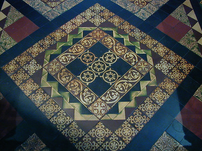 The floors are richly inlaid. Attention all quilters. Here's a design for you to emulate.