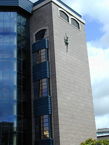 Modern Dublin is full of interesting eccentricities. Here is the Treasury Building. On the wall is a sculpture of person scaling it.
