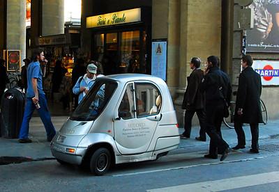 Cars: 3-wheeled  electric.