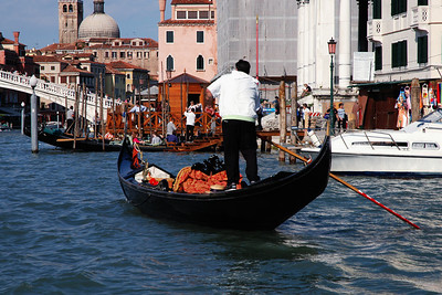 "Venice: A photo essay on Venice would be incomplete without the classic ""gondola picture."" This is on the Grand Canal just before it empties into the Med near Piazza San Marco."