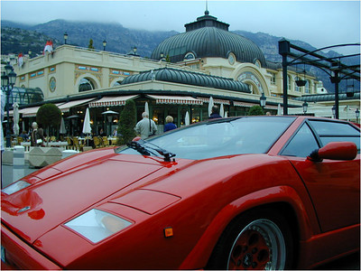 I feel secure in my belief that Monte Carlo has more luxury cars per capita than any place on earth. This Ferrari was parked just in front of the Grand Casino and the picture is taken toward the Northeast just before dusk. There's a fashionable restaurant in the background.