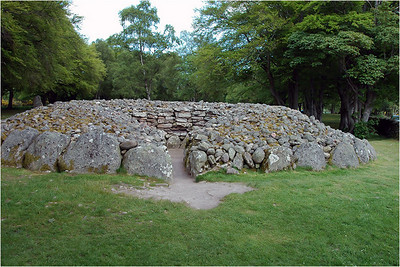 I have seen many of these sites in the UK. Of them, the ones at Newgrange just north of Dublin Ireland were the best preserved. All share the same basic plan. All share the orientation with the sun on a particular day. All appear to have been constructed of dry stone with a capstone roof.