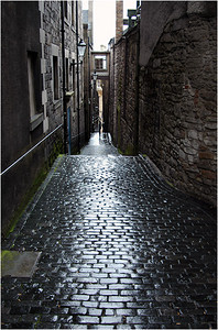 Off all the main streets are little bitty streets and alleys called closes. Here's a view down one of them, the streets obviously wet from a recent shower. Much of the city is built of stone and gives a gray appearance which is only heightened by the rain.