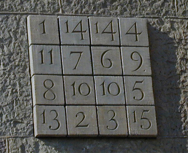 Subirach's cryptogram mounted on the facade. It s a magic square with all rows and columns adding to 33. In fact, there are dozens of regular symmetric combinations of 4 squares which add to 33. An adornment to a cathedral that could only have been conceived in the 20th century.