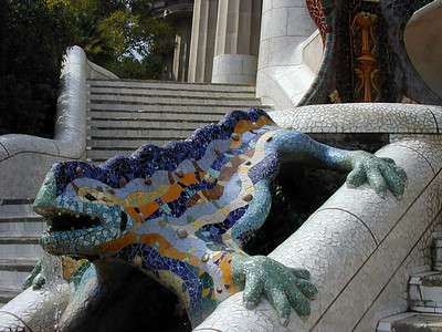 Guarding the entrance to Parc Guell, Draco, the dragon. The curved forms with bright colored tiles are as immediately recognizable as the Moorish arches and tiles of the Alhambra.