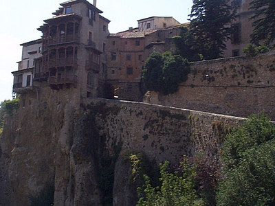 Cuenca Casas Colgados. The hanging houses of Cuenca are perched on the very edge of a 500 foot cliff. The Parador Hotel is just across the narrow valley and offers a nice view of the skyline of old Cuenca.