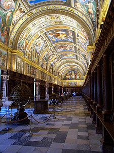 The library is the most ornate room in the palace which boasts 2,600 windows, 100 miles of passage ways, a length of 200 meters and a width of 150 meters. If you doubt me, these metrics are in every guide book I've seen. That's boasting.