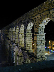 In the contrast of bright lights on a dark night, it is easy to see the individual stones of the aqueduct. These stones were laid in place 1,000 years ago without benefit of mortar or cement. Held in place by gravity and perfectly balanced forces of weight and mass, they stand today unaltered by time.