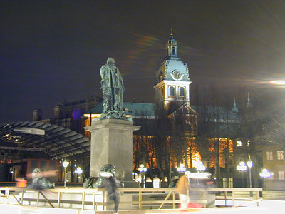 Nearby was a brightly lit square, flooded and frozen for ice skating. A stately church stands guard in the background as skaters whiz around the statue in the center of the ice.