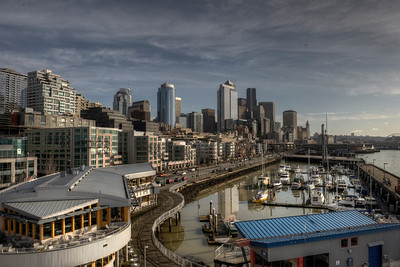 Seattle skyline from Belltown.  To answer Melethia's question: I used my standard HDR work flow. 7 photos taken 2/3 of an f/stop apart from -2 to +2 stops in total. I set ISO at 400 and aperture at f/9, the sweet spot for my Nikon 24-70 f/2.8 lens. Normally I would use a tripod but I didn't have one with me so I shot it handheld. Thankfully I'm pretty steady and the heavy D3 doesn't move much ... with a lens, the camera weighs about 8-9 pounds and it has a lot of inertia. I also get quite a workout on a day long shoot :)  Shutter speed was around 1/4000 on the shortest exposure. That may seem overly fast but Photomatix does a good job aligning photos that have no motion blur so when I know I'm going HDR I try to shoot fast. My camera does burst mode so the total elapsed time to shoot the 7 exposures was about 3/4 of a second.  I imported the seven RAW files into Photomatix to create an aligned HDR image and tone mapped it with Photomatix. I saved the results and opened the tone mapped image in Photoshop CS5. I then resized and cropped to yield 3000x2000 image but no further post processing was required. Save for web and publish to Smug Mug.  If this was headed to a client or a commercial destination ... I would do a little cleanup of minor sensor dust and do some destination specific sharpening ... but I didn't do it here.