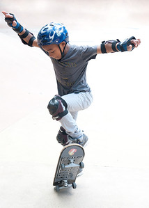 """Shot a """"new friend"""" practicing skateboard maneuvers. Sent him these photos by email in return for permission to shoot him practicing his moves."""