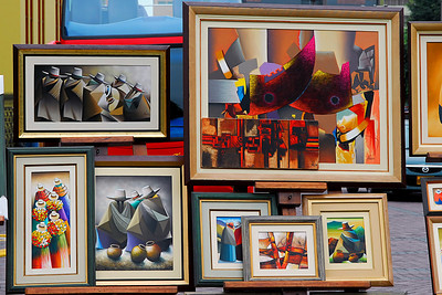 Along the street bordering the park was a market. It felt a lot like a craft fair because what  was was on offer was mostly art and jewelry. Throughout our trip we saw quite a lot of what I think of as Peruvian cultural art. Much of it was abstract or highly stylized. These two pictures will give you a good idea of it.