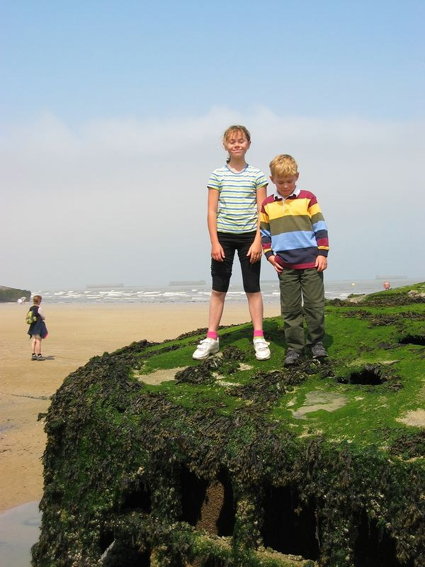 Arromanches, France.  K&J have to cawl over the wreckage.