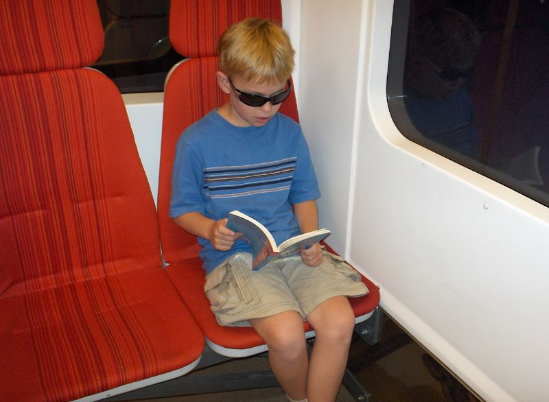Jordan reading Harry Potter on the subway in Prague