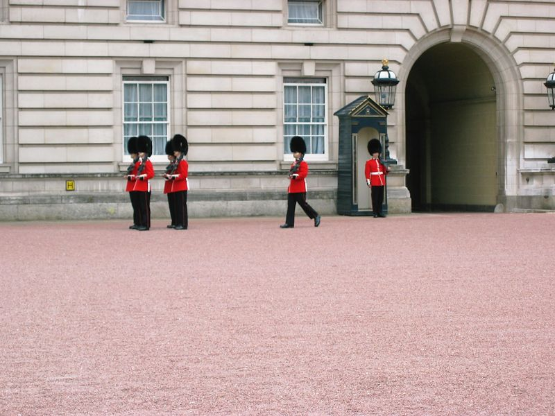 "Buckingham Palace.  This wasn't the ""Official"" changing of the guard, but they changed places anyway.  We decided that one of them must have needed a potty break."