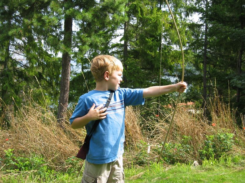 Practicing archery skills at our cabin