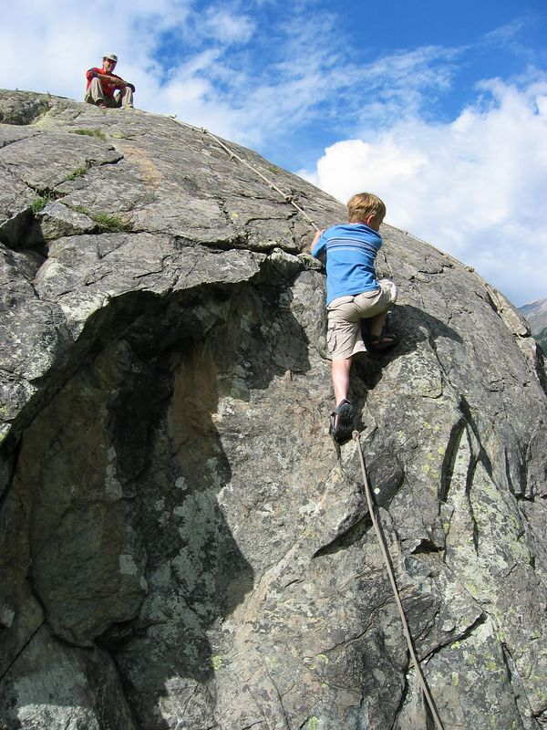 Climbing the infamous rock.
