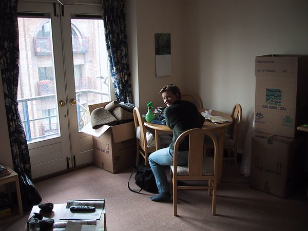 D0002.JPG - 25/05/01 4:19pm   Ange sitting at the dining table in the flat.  The doors in the background lead out onto the balcony from where the above photos were taken.