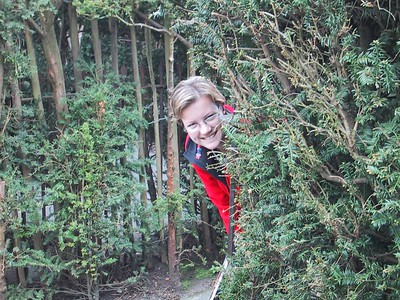 D0031.JPG - 03/05/01 2:25pm   In the back yard at the palace, there is a maze planted in 1690 that visitors can walk through and see if they get lost or not.  Well of course....we got lost....this is Ange playing silly-buggers in the maze.