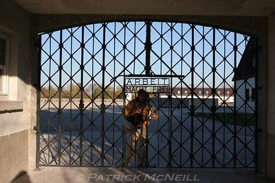 "Dachau concentration camp - The words on the gate say ""work will set you free"""