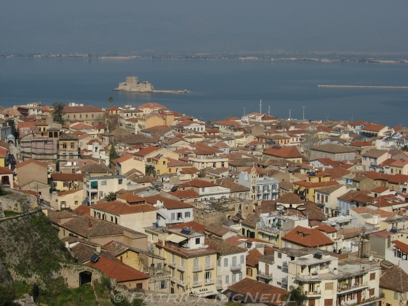 The old town of Nafplio. Lots of character buildings, two hilltop castles, and also a fortress in the bay.